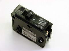 A Full Size 15 Amp Circuit Breaker